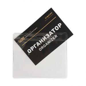 Transparent plastic holder for a badge